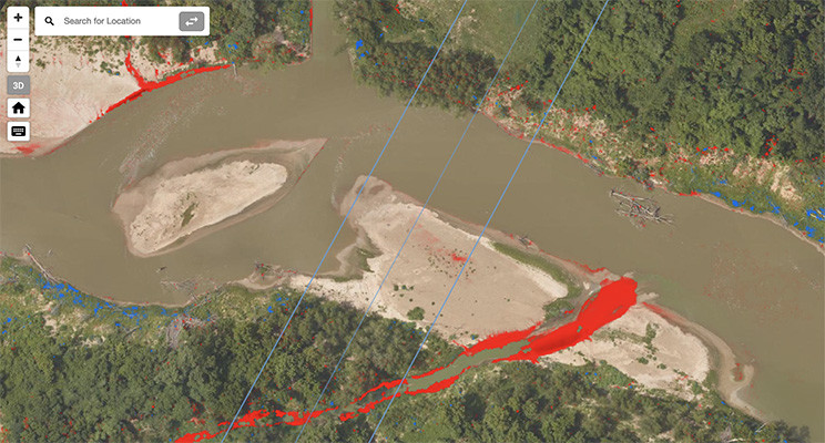 Eroded river bank along a tributary shown in red. Pipeline and Right of Way location marked by blue lines.